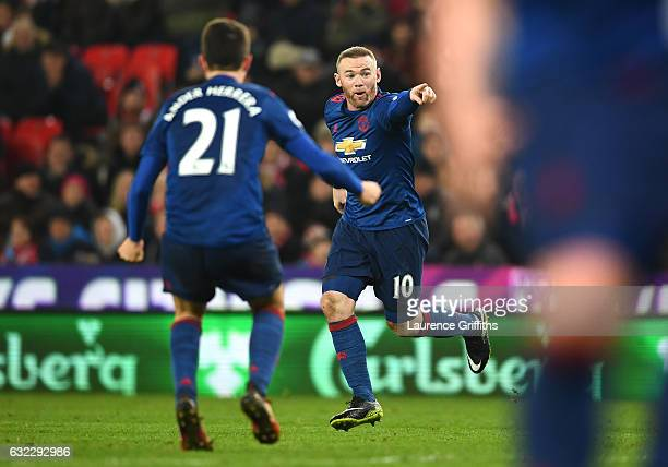 Wayne Rooney of Manchester United celebrates scoring his sides first goal during the Premier League match between Stoke City and Manchester United at...