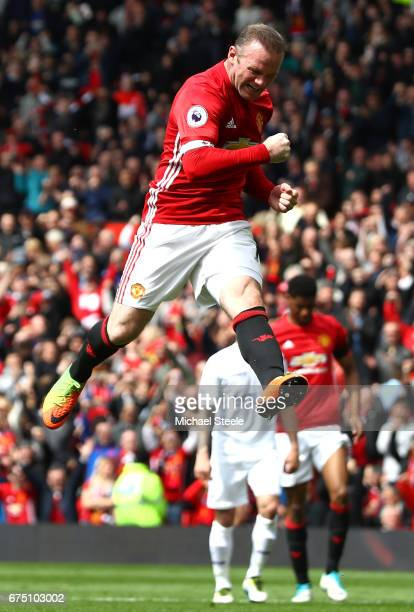 Wayne Rooney of Manchester United celebrates scoring his sides first goal during the Premier League match between Manchester United and Swansea City...