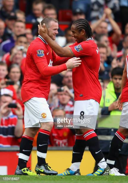 Wayne Rooney of Manchester United celebrates scoring his side's fourth goal with team mate Anderson during the Barclays Premier League match between...