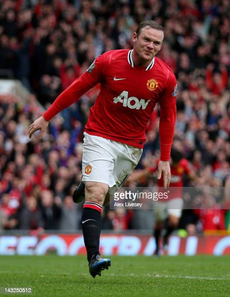 Wayne Rooney of Manchester United celebrates scoring his team's fourth goal during the Barclays Premier League match between Manchester United and...