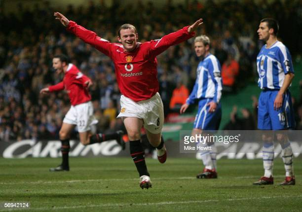Wayne Rooney of Manchester United celebrates scoring his team's fourth goal during the Carling Cup Final match between Manchester United and Wigan...