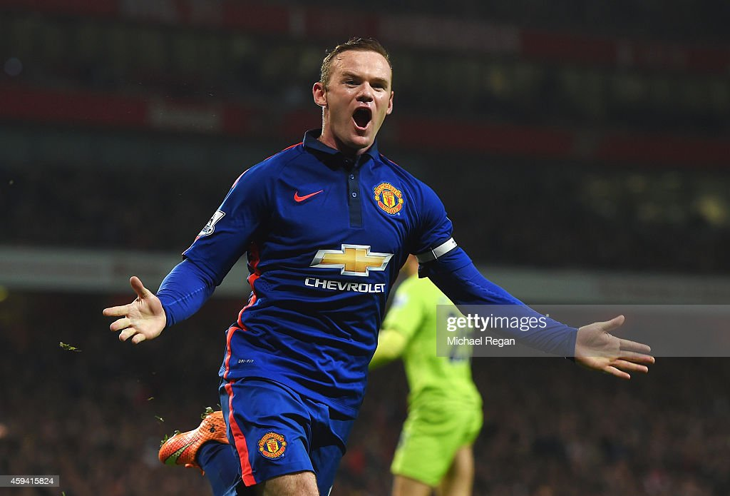 Wayne Rooney of Manchester United celebrates scoring his team's second goal during the Barclays Premier League match between Arsenal and Manchester United at Emirates Stadium on November 22, 2014 in London, England.