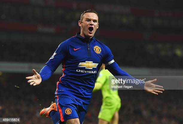 Wayne Rooney of Manchester United celebrates scoring his team's second goal during the Barclays Premier League match between Arsenal and Manchester...
