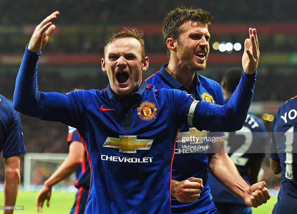 Wayne Rooney of Manchester United celebrates scoring his team's second goal with Michael Carrick of Manchester United during the Barclays Premier League match between Arsenal and Manchester United at Emirates Stadium on November 22, 2014 in London, England.