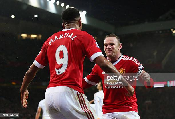 Wayne Rooney of Manchester United celebrates scoring his team's second goal with his team mate Anthony Martial during the Barclays Premier League...