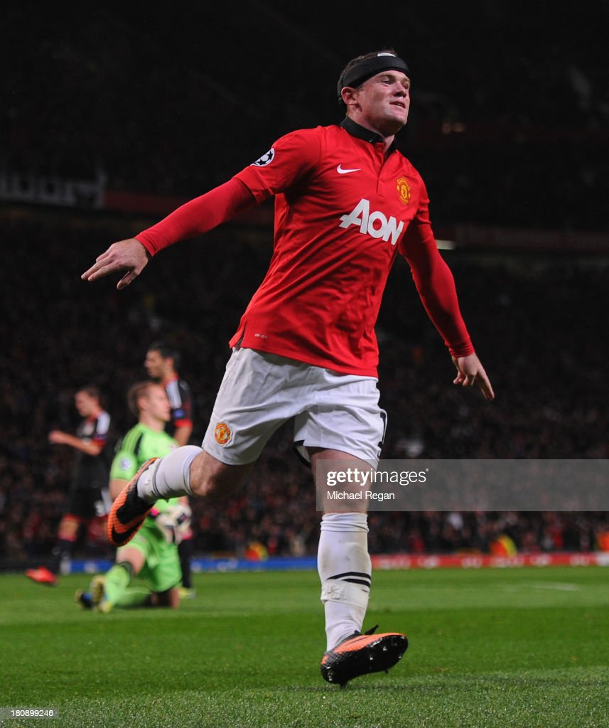 Wayne Rooney of Manchester United celebrates scoring his team's third goal during the UEFA Champions League Group A match between Manchester United and Bayer Leverkusen at Old Trafford on September 17, 2013 in Manchester, England.