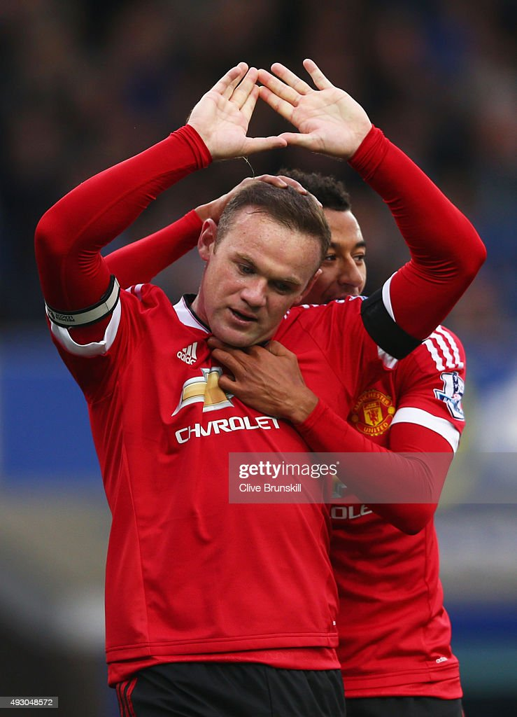 Wayne Rooney of Manchester United celebrates scoring his team's third goal with his team mate Jesse Lingard during the Barclays Premier League match between Everton and Manchester United at Goodison Park on October 17, 2015 in Liverpool, England.