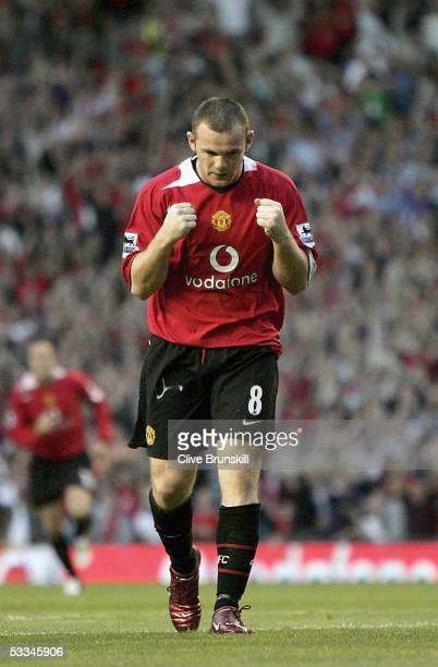 Wayne Rooney of Manchester United celebrates scoring the first goal during the Champions League third qualifying round, first leg match between...