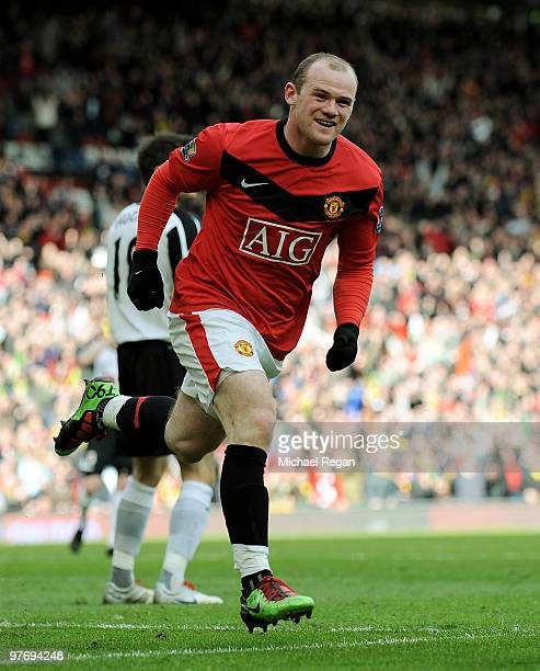 Wayne Rooney of Manchester United celebrates scoring the first goal during the Barclays Premier League match between Manchester United and Fulham at...