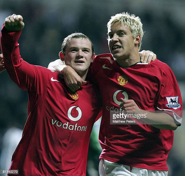 Wayne Rooney of Manchester United celebrates scoring the fourth goal with Alan Smith during the Barclays Premiership match between Newcastle United...