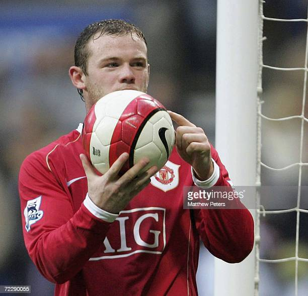 Wayne Rooney of Manchester United celebrates scoring the fourth goal and completing his hattrick during the Barclays Premiership match between Bolton...