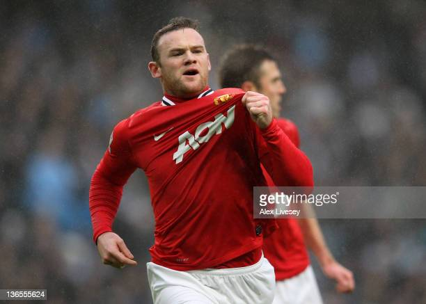 Wayne Rooney of Manchester United celebrates scoring the opening goal during the FA Cup Third Round match between Manchester City and Manchester...