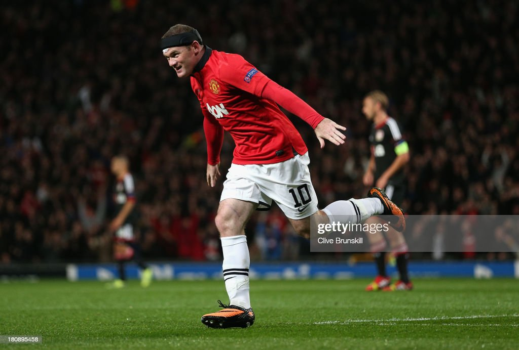 Wayne Rooney of Manchester United celebrates scoring the opening goal during the UEFA Champions League Group A match between Manchester United and Bayer Leverkusen at Old Trafford on September 17, 2013 in Manchester, England.