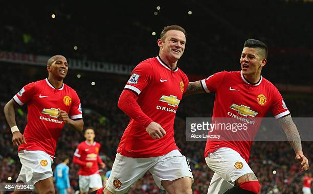Wayne Rooney of Manchester United celebrates scoring the opening goal with Marcos Rojo and Ashley Young of Manchester United during the Barclays...