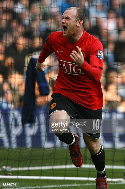 Wayne Rooney of Manchester United celebrates scoring the opening goal during the Barclays Premier League match between Manchester City and Manchester...