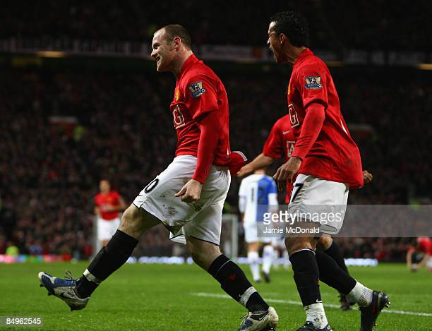 Wayne Rooney of Manchester United celebrates scoring the opening goal with team mate Nani during the Barclays Premier League match between Manchester...