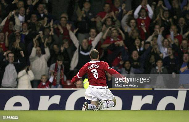 Wayne Rooney of Manchester United celebrates scoring the second goal during the UEFA Champions League match between Manchester United and Fenerbahce...