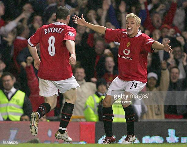 Wayne Rooney of Manchester United celebrates scoring the second goal with Alan Smith during the Barclays Premiership match between Manchester United...