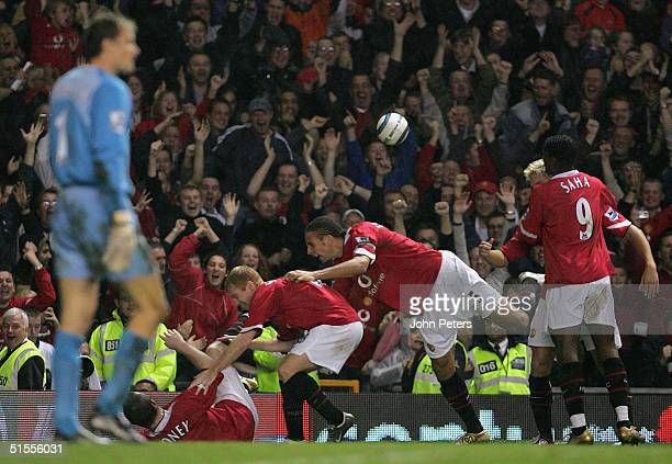 Wayne Rooney of Manchester United celebrates scoring the second goal with Paul Scholes and Rio Ferdinand during the Barclays Premiership match...