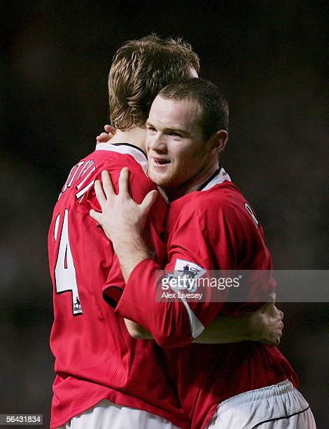 Wayne Rooney of Manchester United celebrates scoring the second goal with Darren Fletcher during the FA Barclays Premiership match between Manchester...