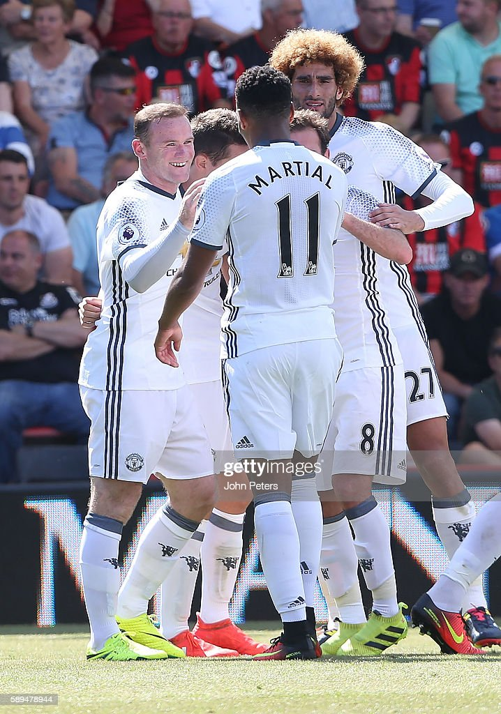 Wayne Rooney of Manchester United celebrates scoring the second goal to make the score 0-2 with his team-mates during the Premier League match between AFC Bournemouth and Manchester United at Vitality Stadium on August 14, 2016 in Bournemouth, England.