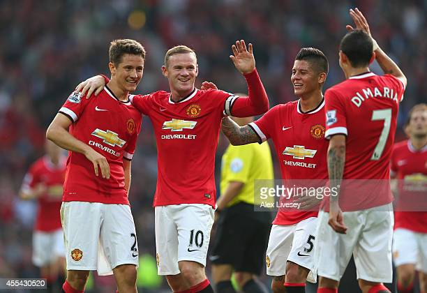 Wayne Rooney of Manchester United celebrates scoring the third goal with team-mates Ander Herrera , Marcos Rojo and Angel Di Maria during the...
