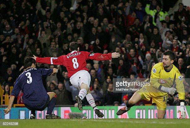 Wayne Rooney of Manchester United celebrates scoring the third goal during the Barclays Premiership match between Manchester United and Portsmouth at...