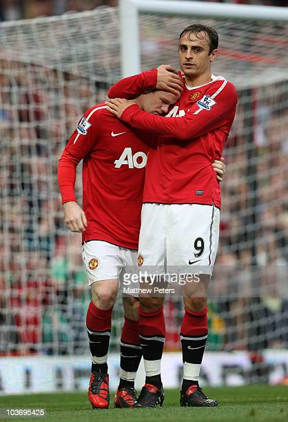 Wayne Rooney of Manchester United celebrates scoring their first goal with Dimitar Berbatov during the Barclays Premier League match between...