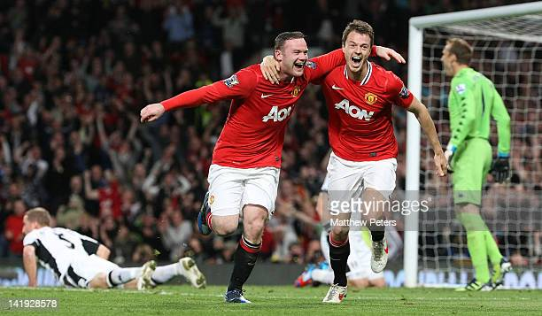Wayne Rooney of Manchester United celebrates scoring their first goal during the Barclays Premier League match between Manchester United and Fulham...