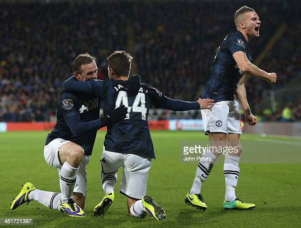 Wayne Rooney of Manchester United celebrates scoring their first goal during the Barclays Premier League match between Cardiff City and Manchester...