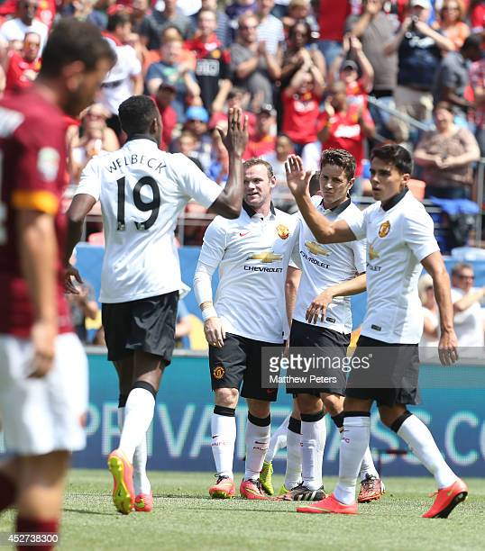 Wayne Rooney of Manchester United celebrates scoring their first goal during the preseason friendly match between Manchester United and AS Roma at...