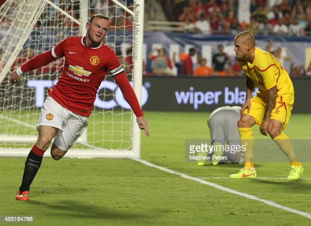Wayne Rooney of Manchester United celebrates scoring their first goal during the preseason friendly match between Manchester United and Liverpool at...