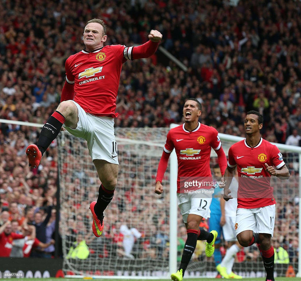 Wayne Rooney of Manchester United celebrates scoring their first goal during the Barclays Premier League match between Manchester United and Swansea City at Old Trafford on August 16, 2014 in Manchester, England.