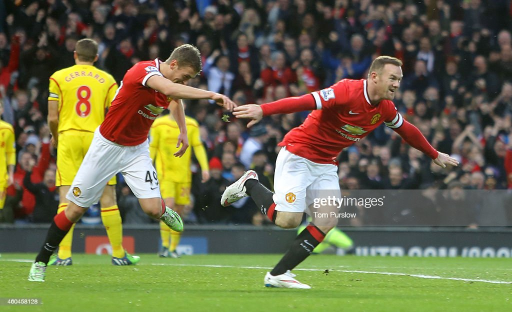 Wayne Rooney of Manchester United celebrates scoring their first goal during the Barclays Premier League match between Manchester United and Liverpool at Old Trafford on December 14, 2014 in Manchester, England.