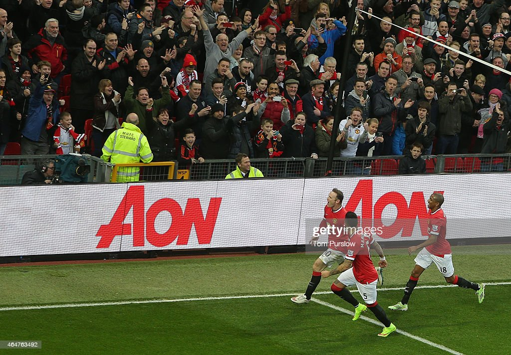 Wayne Rooney of Manchester United celebrates scoring their first goal during the Barclays Premier League match between Manchester United and Sunderland at Old Trafford on February 28, 2015 in Manchester, England.