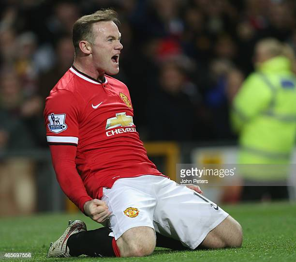Wayne Rooney of Manchester United celebrates scoring their first goal during the FA Cup Quarter Final match between Manchester United and Arsenal at...