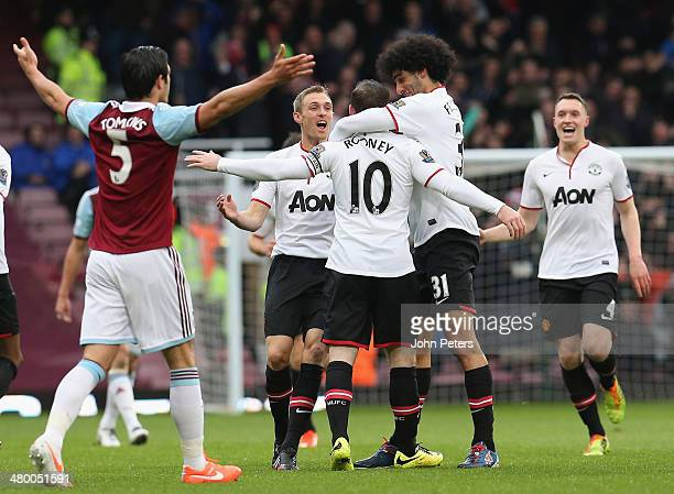 Wayne Rooney of Manchester United celebrates scoring their first goal during the Barclays Premier League match between West Ham United and Manchester...