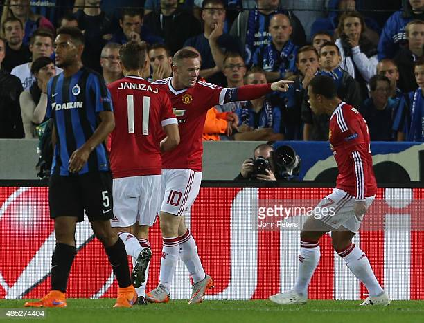 Wayne Rooney of Manchester United celebrates scoring their first goal during the UEFA Champions League playoff second leg match between Club Brugge...