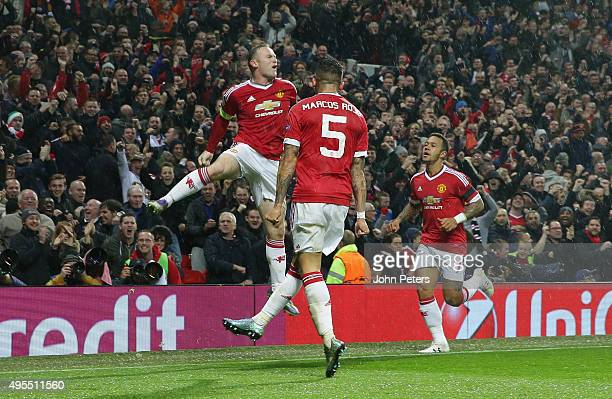 Wayne Rooney of Manchester United celebrates scoring their first goal during the UEFA Champions League match between Manchester United and CSKA...
