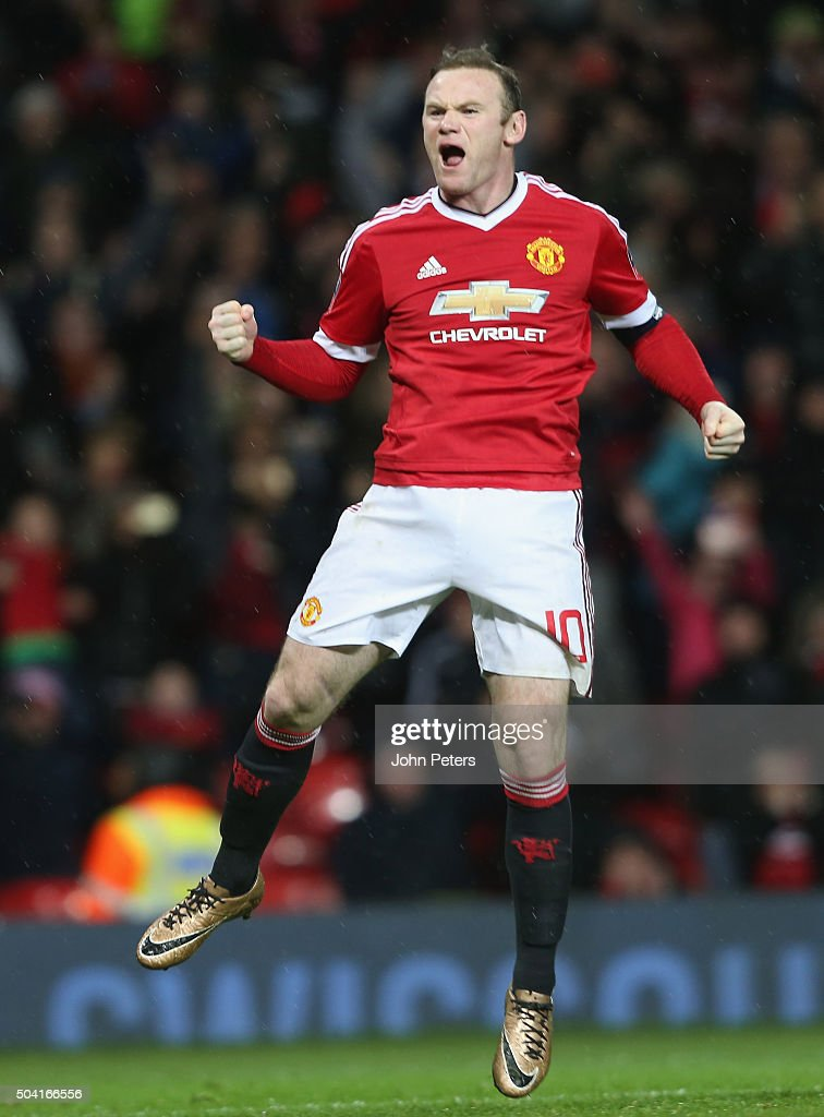 Wayne Rooney of Manchester United celebrates scoring their first goal during the Emirates FA Cup Third Round match between Manchester United and Sheffield United at Old Trafford on January 9, 2016 in Manchester, England.