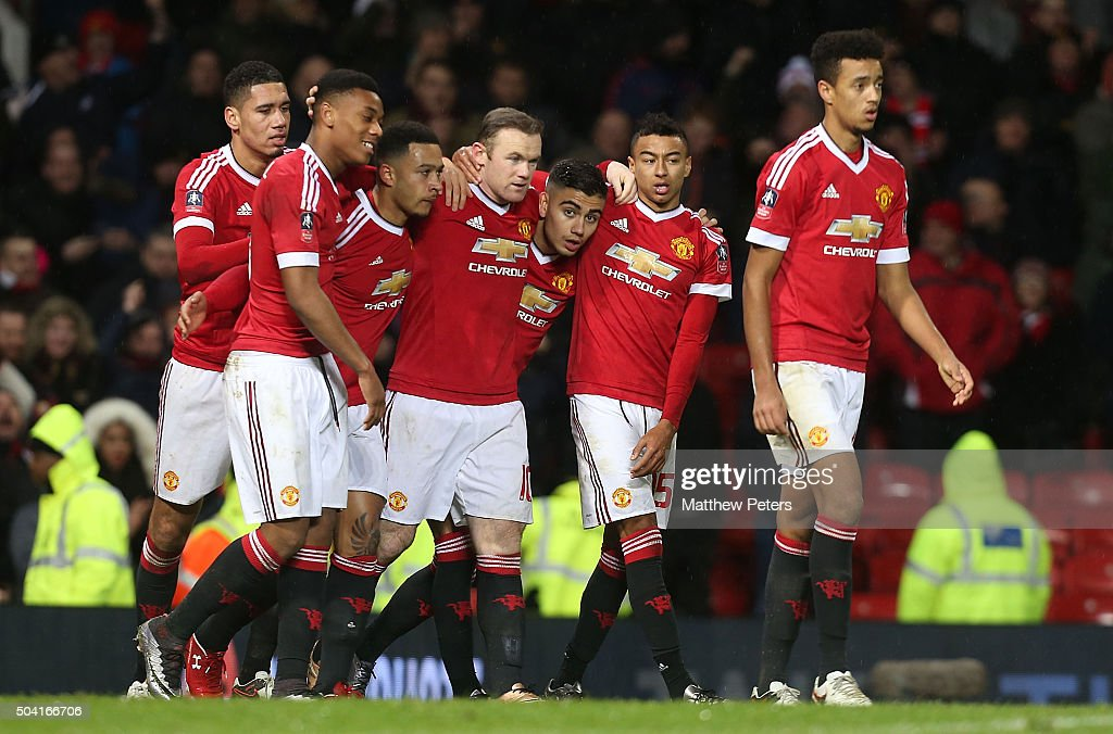 Wayne Rooney (C) of Manchester United celebrates scoring their first goal during the Emirates FA Cup Third round match between Manchester United and Sheffield United at Old Trafford on January 9, 2016 in Manchester, England.