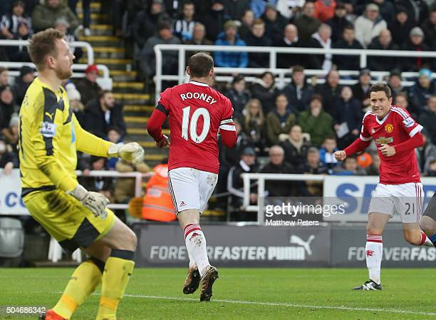 Wayne Rooney of Manchester United celebrates scoring their first goal during the Barclays Premier League match between Newcastle United and...