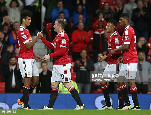 Wayne Rooney of Manchester United celebrates scoring their first goal during the Barclays Premier League match between Manchester United and AFC...