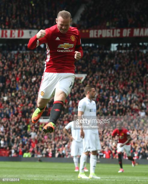 Wayne Rooney of Manchester United celebrates scoring their first goal during the Premier League match between Manchester United and Swansea City at...