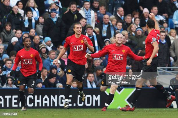 Wayne Rooney of Manchester United celebrates scoring their first goal during the Barclays Premier League match between Manchester City and Manchester...