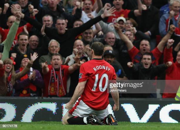 Wayne Rooney of Manchester United celebrates scoring their first goal during the FA Barclays Premier League match between Manchester United and...