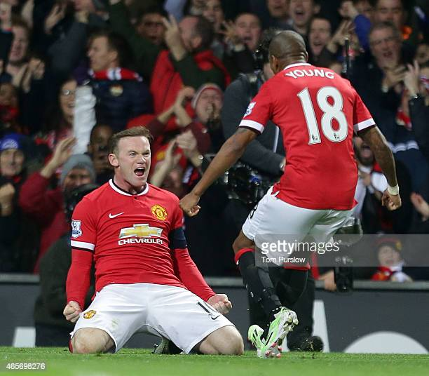 Wayne Rooney of Manchester United celebrates scoring their first goalduring the FA Cup Quarter Final match between Manchester United and Arsenal at...