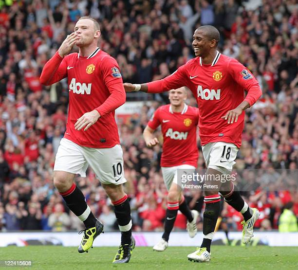 Wayne Rooney of Manchester United celebrates scoring their fourth goal during the Barclays Premier League match between Manchester United and Arsenal...