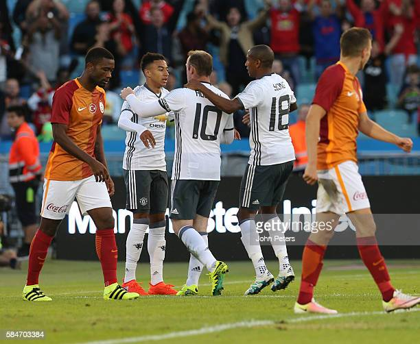 Wayne Rooney of Manchester United celebrates scoring their second goal of Galatasary during the preseason friendly match between Manchester United...