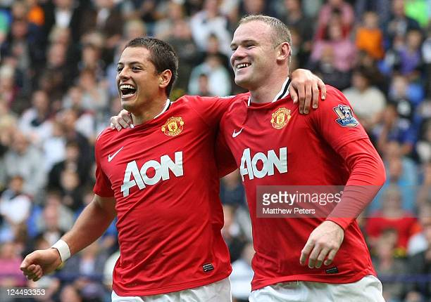 Wayne Rooney of Manchester United celebrates scoring their second goal with Javier 'Chicharito' Hernandez during the Barclays Premier League match...